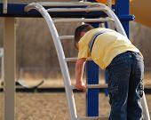 Boy Climbing At Playground