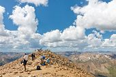 Hikers On The Summit Of Mount Elbert