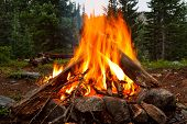 stock photo of firewood  - Campfire at Wilderness Campsite in the Rocky Mountains Colorado - JPG