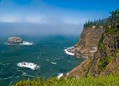 stock photo of mear  - Rugged Rocky Coastline on the Oregon Coast Overlook from Cape Meares Lighthouse - JPG