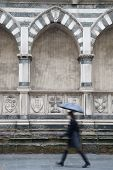 Santa Maria Novella Church; Florence; Italy With Woman Walking With Umbrella