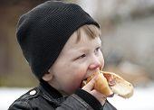 Enjoying A Hotdog