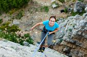 Woman Practices In Climbing At The Rock In The Crimea Mountains