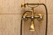 Vintage Bathtub Faucet And Ceramic Tiles In Background