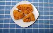 Four Pieces Of Fried Chicken