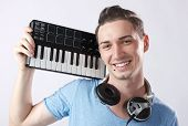 Deejay With Headphones And Midi Keyboard On Shoulder