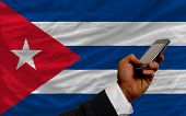 Cell Phone In Front  National Flag Of Cuba