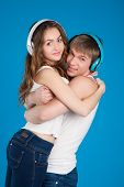 Young Love Couple. Boy Holding Girl. Wearing Headphones
