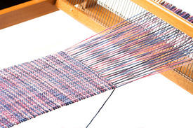 stock photo of handloom  - Old wooden handloom and nice weaving project - JPG