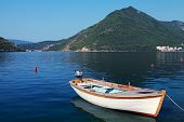 White Wooden Fishing Boat Floats Moored In Perast Town, Adriatic Sea, Montenegro