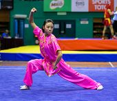 KUALA LUMPUR - NOV 03: Emily Fan of the USA shows her fighting style in the 'changquan compulsory' e