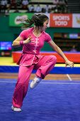 KUALA LUMPUR - NOV 03: Elizabeth Lim of Australia shows her fighting style in the 'Nan quan compulso