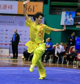 KUALA LUMPUR - NOV 03: Yeap Wai Kin of Malaysia shows his fighting style in the 'changquan compulsory' event at the 12th World Wushu Championship on November 03, 2013 in Kuala Lumpur, Malaysia.