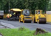 picture of spreader  - asphalt spreader is used to place the first layer of asphalt on a city street renewal project - JPG