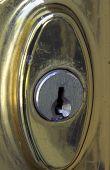 Old Weathered Brass Door Lock poster