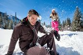 stock photo of snowball-fight  - young couple having fun in snow - JPG
