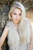Portrait Of A Beautiful Young Girl In Fur