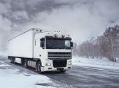 stock photo of snowy-road  - Winter freight transportation by truck - JPG