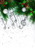 Photo of Christmas tree border, silver treble clef, festive melody on the notes page, musical sound,