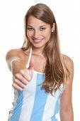 Female argentinian football fan showing thumb