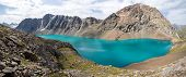 Panoramic view of Ala-Kul lake in Kyrgyzstan