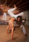 Helping Capoeira Partner With Handstand
