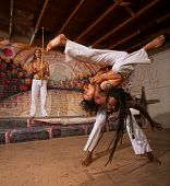 Capoeira Performers Shoulder Throw