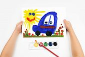 Child draws the car watercolors