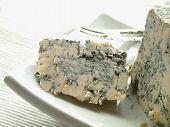 traditional English Stilton cheese on white platter