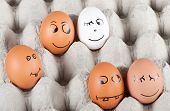 Group Of  Funny Smiling Eggs In A Packet