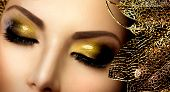 Fashion Glamour Makeup. Glamor Golden Make-up. Holiday Gold Glittering Eyeshadows