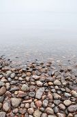 Coastal Stones On Saimaa Lake In Foggy Morning