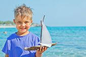 boy with toy ship