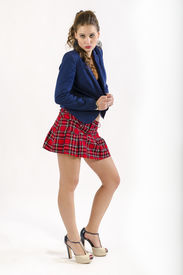 stock photo of youg  - Sexy youg woman looks as schoolgirl or schoolmate - JPG