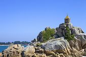 Coast of France in Brittany, the famous small chapel at the rocks in Port-Blanc