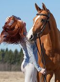 image of horses ass  - Beautiful red haired girl and red horse - JPG