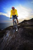 Young Man Riding Moutain Bike Mtb On Land Dune Against Dusky Sky In Evening Background Use For Sport