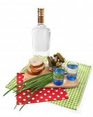 Composition with bottle of vodka and marinated mushrooms, cucumbers on wooden board isolated on whit