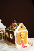 Gingerbread house on brown background