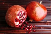 Ripe pomegranates on bamboo mat background