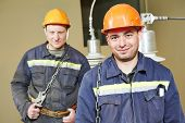 stock photo of lineman  - Industrial electrician lineman repairman workers team - JPG