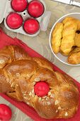 Easter sweet brioche with red eggs and vanilla cookies