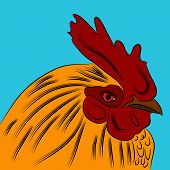 An image of a golden orange rooster.