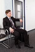 Anxious Man Sitting On Chair