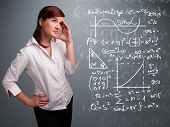 Beautiful young school girl thinking about complex mathematical signs