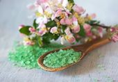 Bath Salt On Wooden Spoon And Flowers