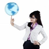 Businesswoman With Globe On Finger