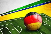 Soccer Ball With Germany Flag On Pitch