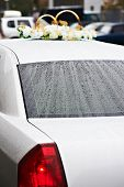 Wedding Car In The Rain With Gold Rings