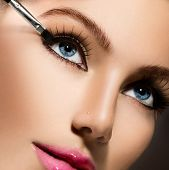 Makeup. Make-up Applying closeup. Eyeliner. Cosmetic Eyeshadows. Eyeline brush for Make up. Beauty G